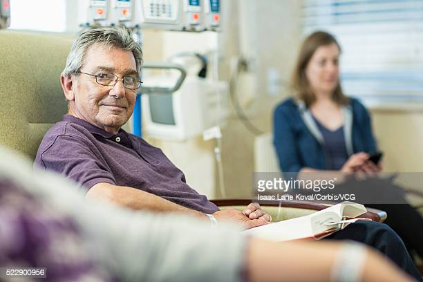 Portrait of patient sitting in infusion room