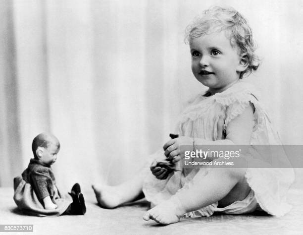 A portrait of Patricia Mountbatten playing with her dolls England July 14 1925 She is the daughter of Lord and Lady Louis Mountbatten and the great...