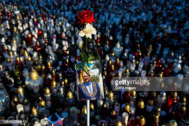 Portrait of Pawel Adamowicz seen among candles during the funeral memorial services Pawel Adamowicz the mayor of the Polish city of Gdansk was...