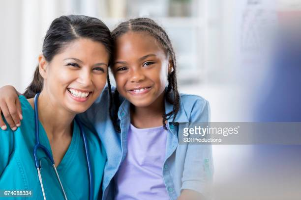 Portrait of pediatrician with young patient