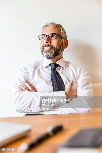 Portrait of pensive businessman at home office