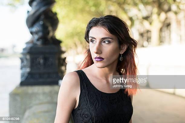 portrait of pensive transgender female looking away - black transgender stock pictures, royalty-free photos & images