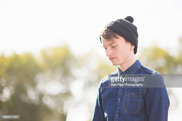 Portrait of pensive young man in knitted hat