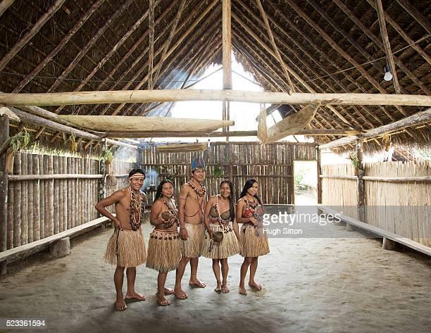 portrait of people in traditional clothes in hut, amazon river basin, ecuador - hugh sitton - fotografias e filmes do acervo