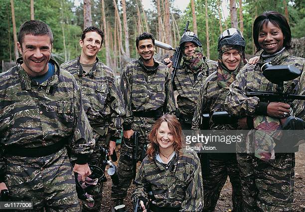 Portrait of People Paintballing Dressed in Camouflage Clothing