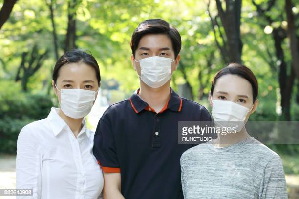 portrait of peopole wearing flu mask - flu mask stock photos and pictures