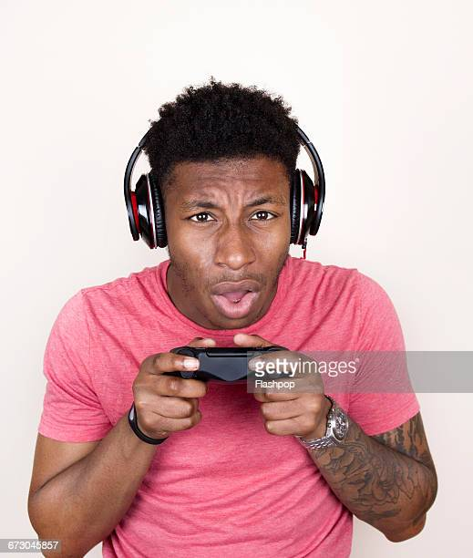 Portrait of person playing with games console