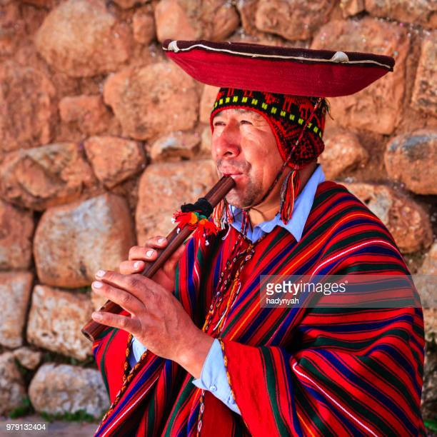 portrait of peruvian man playing a flute, sacred valley - inca stock pictures, royalty-free photos & images