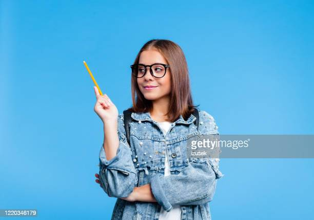 portrait of petty teenage girl holding pensil - person in education stock pictures, royalty-free photos & images