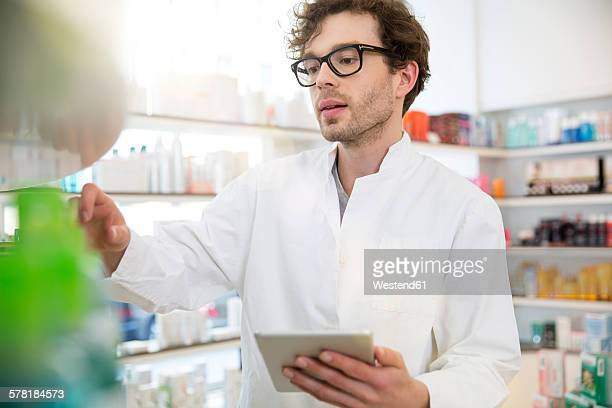 Portrait of pharmacist doing inventory control with digital tablet
