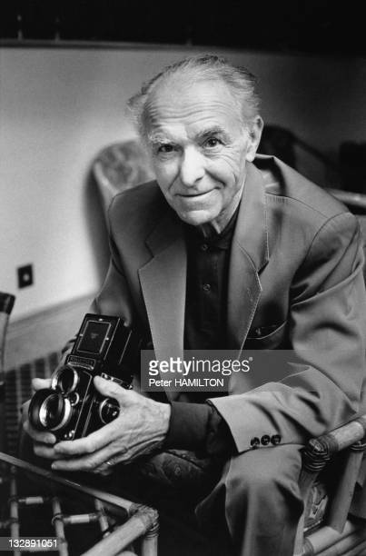 Portrait of photographer Robert Doisneau with a camera Rolleiflex during 1992 in France