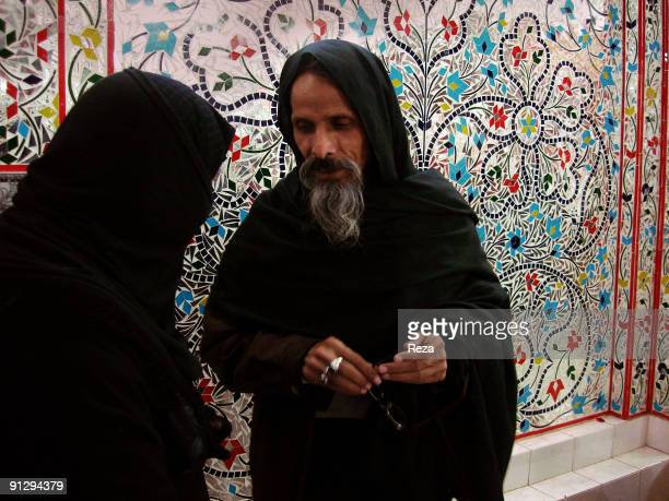 Portrait of pilgrims inside the shrine of Bodla Bahar one of the main disciples of Lal Shahbaz Qalandar a 13th century Sufi Master worshiped alike by...