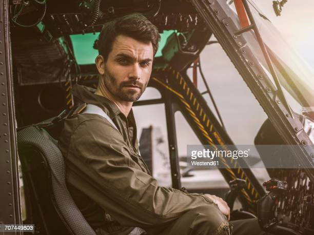 Portrait of pilot in cockpit of a helicopter