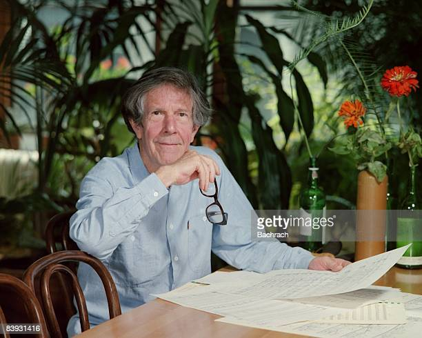Portrait of pioneering avant garde composer and pianist John Cage smiling with his chin resting on his right hand Taken in his apartment 1983 New York