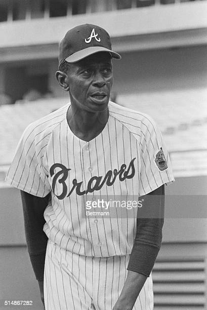 Portrait of pitcher Satchel Paige, a veteran of the Negro Leagues, various Major League and minor league teams, in uniform as a pitching coach for...