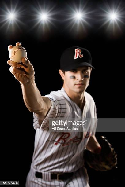 portrait of pitcher throwing baseball - 投手 ストックフォトと画像