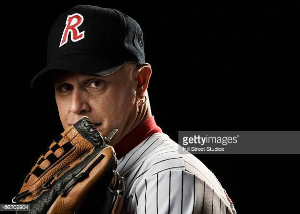 portrait of pitcher with baseball glove - キャッチャーミット ストックフォトと画像