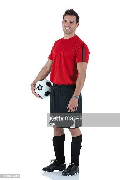 porträt-spieler hält einen fußball - trikot stock-fotos und bilder