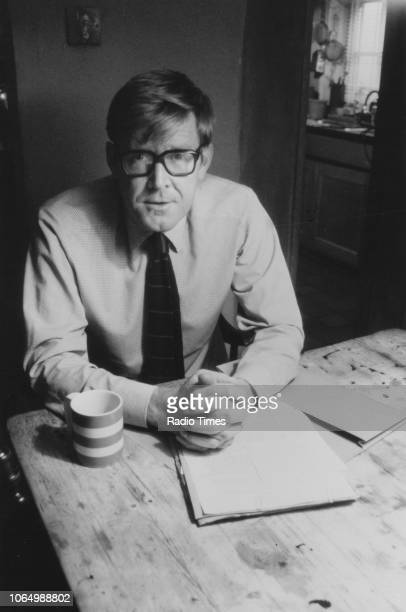 Portrait of playwright Alan Bennett in his home photographed for Radio Times in connection with the television show 'Play for Today Intensive Care'...