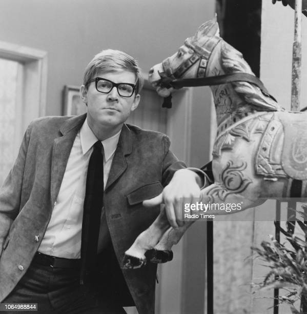 Portrait of playwright Alan Bennett on the set of the television show 'On the Margin' 1964