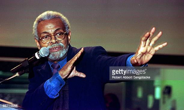 Portrait of poet Amiri Baraka speaking animatedly at the 13th annual Gwendolyn Brooks Writers' Conference held at Chicago State University 2003