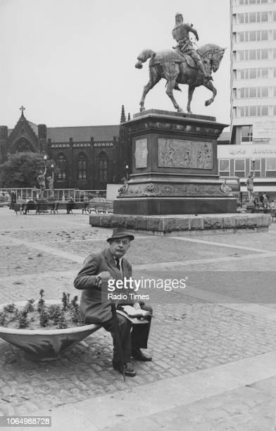 Portrait of poet John Betjeman sitting in the city centre of Leeds circa 1970