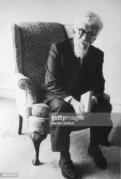 Portrait of Polish-born American rabbi and social activist Abraham Heschel as he sits forward in an armchair, a book in his hands, 1968.