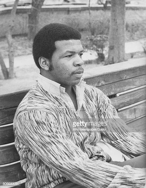 Portrait of politician and Maryland congressional representative Elijah Cummings sitting on a bench 1975