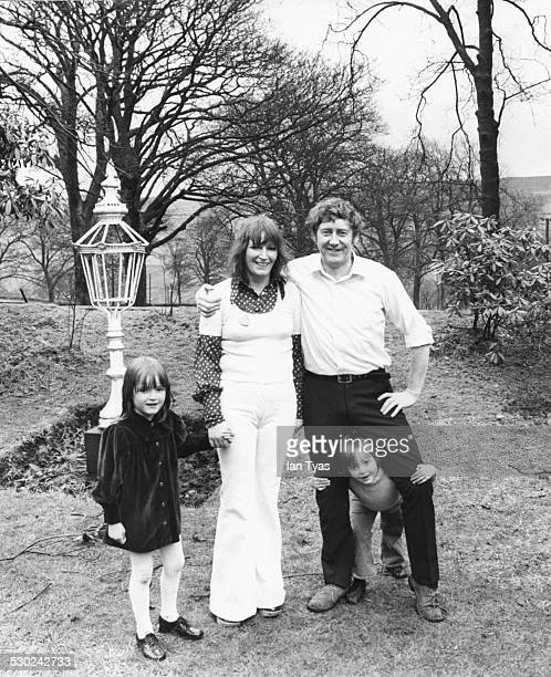 Portrait of politician Austin Mitchell with his wife and children in the garden of their home circa 1970