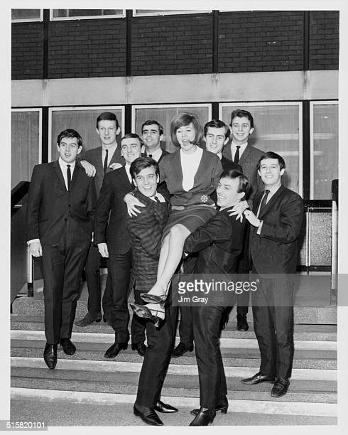 Portrait of pop stars Billy J Kramer Cilla Black and Gerry Marsden standing in from of the rest of the band 'Gerry and the Pacemakers' and 'The...