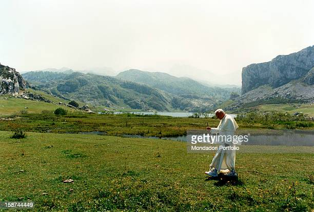 Portrait of Pope John Paul II born Karol JÛzef Wojtyla who dipped in a bucholic landscape rich of waterays peacefully and thoughtfully walks in the...