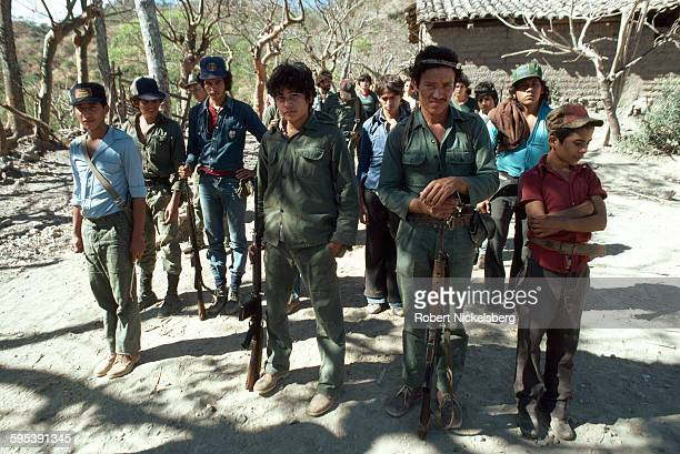 Portrait of Popular Forces of Liberation guerrillas as they stand in formation at a camp near Santa Anita in Chalatenango Province El Salvador...