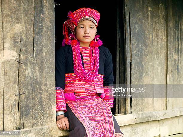 Portrait of Porpae an unmarried Ko Pala ethnic minority girl wearing her traditional costume at home Ban Honglerk Phongsaly Province Lao PDR The...