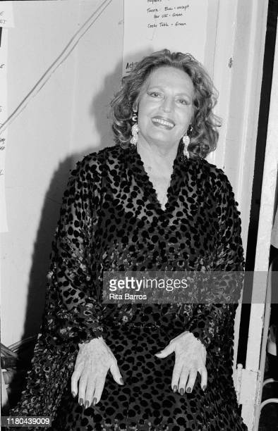 Portrait of Portuguese Fado singer Amalia Rodrigues as she poses backstage during an appearance at Town Hall New York New York November 2 1990
