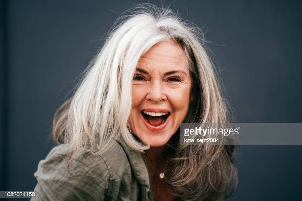 portrait of positive enior woman in her 60s - 60 64 years stock pictures, royalty-free photos & images