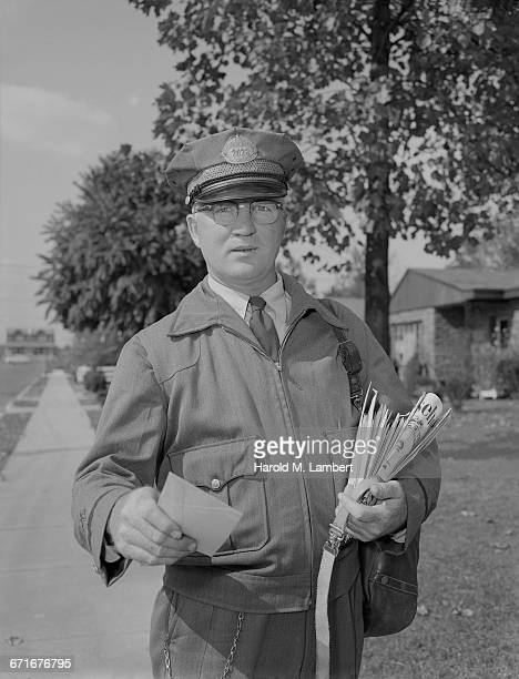 portrait of postal worker holding letter - number of people stock pictures, royalty-free photos & images