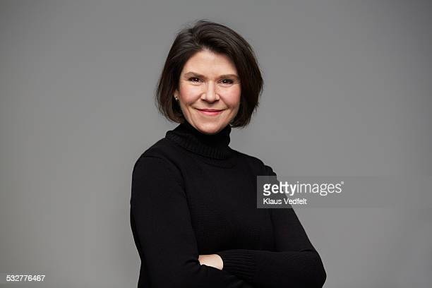 portrait of powerful mature woman - turtleneck stock pictures, royalty-free photos & images