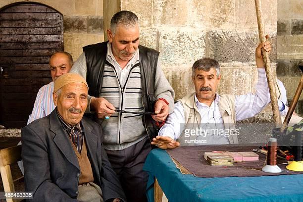 Portrait of prayer beads repairman
