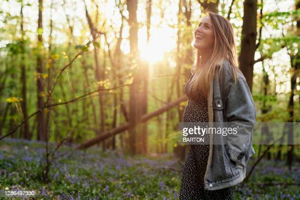 portrait of pregnant woman in woodland - greater london stock pictures, royalty-free photos & images