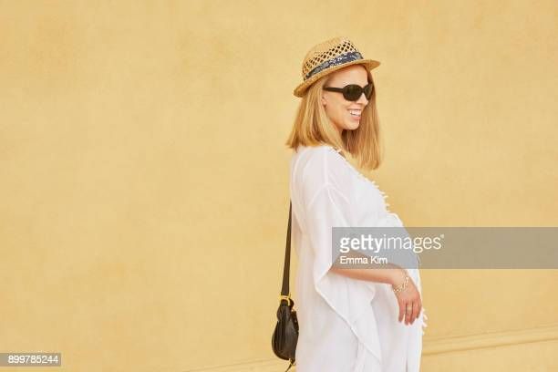 portrait of pregnant woman - maternity wear stock pictures, royalty-free photos & images