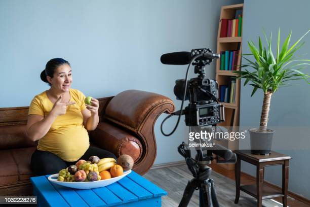 Portrait Of Pregnant Woman Vlogger In Front Of Camera