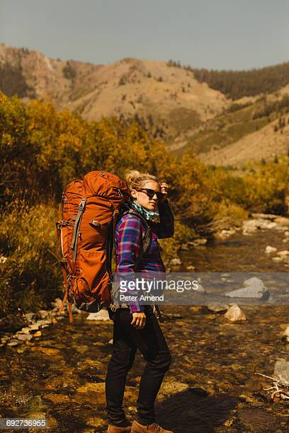 Portrait of pregnant woman wearing backpack, Mineral King, Sequoia National Park, California, USA