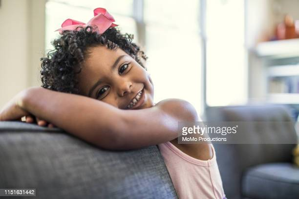portrait of preschool age girl at home - hair bow stock pictures, royalty-free photos & images