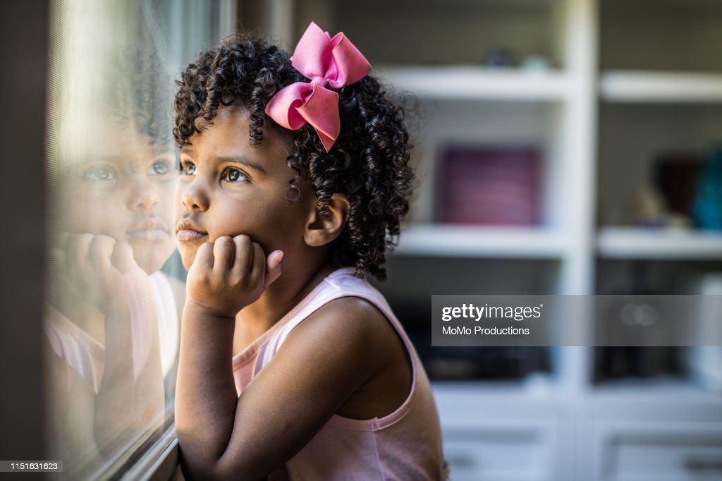 Portrait Of Preschool Age Girl Looking Out Window High Res Stock Photo Getty Images