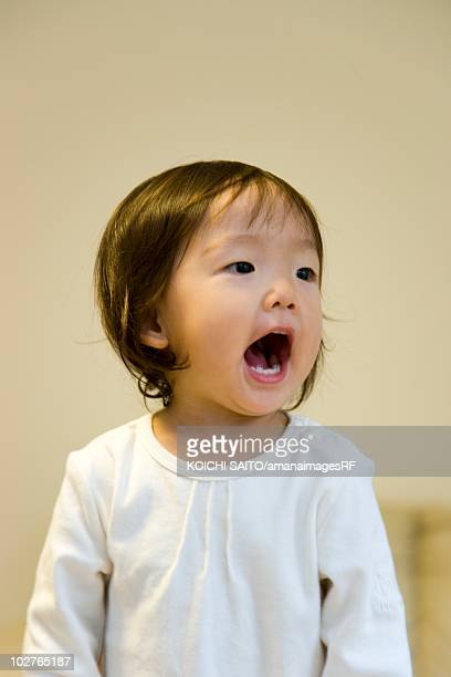 portrait of preschool age girl with her mouth open - girls open mouth stock photos and pictures