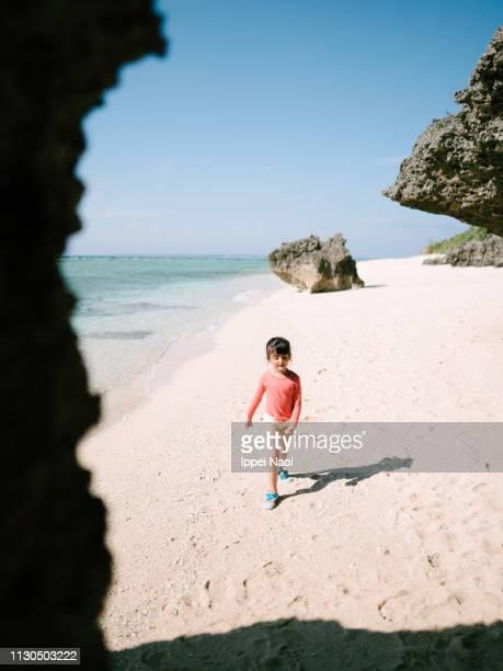 Portrait of preschool girl on idyllic tropical beach, Okinawa, Japan