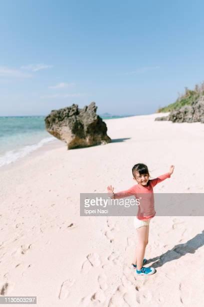 Portrait of preschool girl on tropical beach, Okinawa, Japan