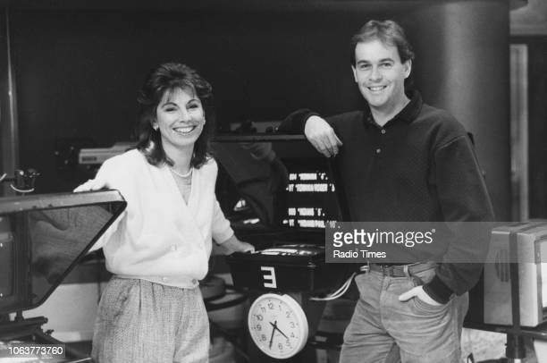 Portrait of presenters Roger Finn and Helen Rollason on the set of the television show 'Newsround' January 11th 1990