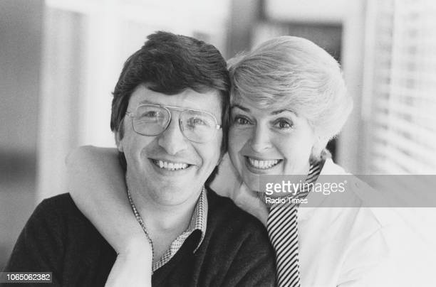 Portrait of presenters Simon Bates and Gloria Hunniford photographed for Radio Times in connection with the BBC Radio 4 series 'Saturday Live' 1982