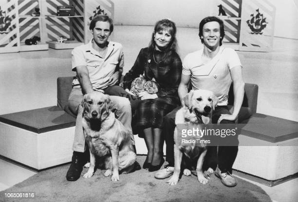 Portrait of presenters Simon Groom Sarah Greene and Peter Duncan on the set of the children's television series 'Blue Peter' with the show's pets...
